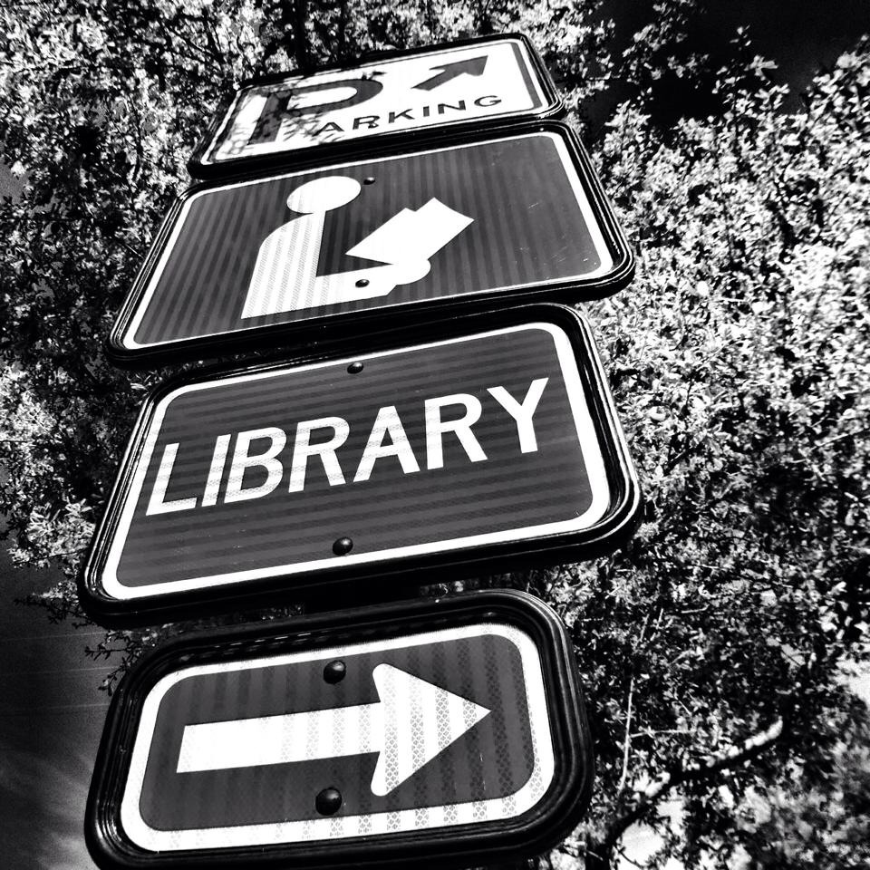 Library sign I saw and I wondered if people ever use the library anymore