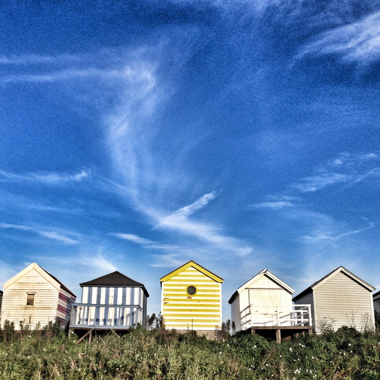 Summer beach huts at Anderby Creek Lincolnshire. Edited with Drama from Snapseed