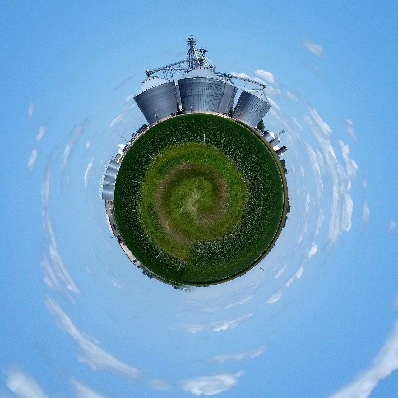Corn silos in central Illinois.<br /> Tiny Planet, Snapped for bringing out the sky.