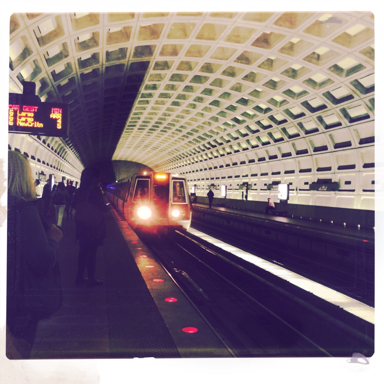 Train arrives at the Ballston Metro<br /> <br /> iPhone 5S <br /> Hipstamatic - Eric lens,...
