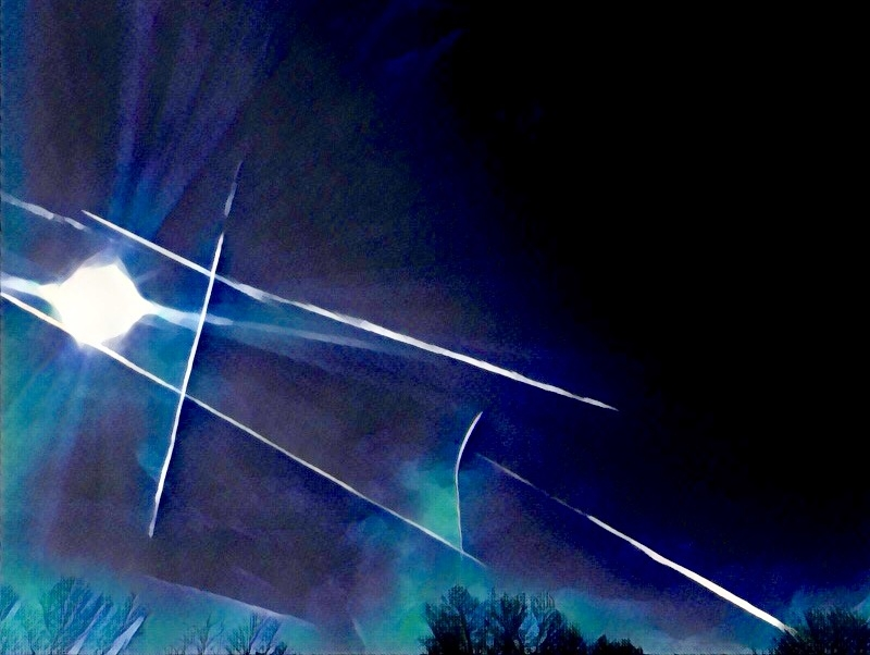 Originally a photo of contrails marking a beautiful blue sky in Memphis. Edited with Prisma app.
